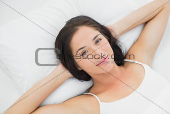 Beautiful young woman resting in bed