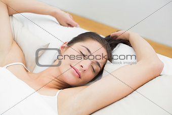 Beautiful woman sleeping in bed with eyes closed