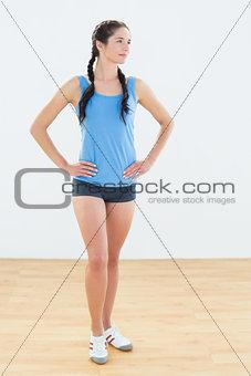 Thoughtful woman in sportswear looking away