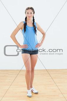 Slim sporty young woman in sportswear