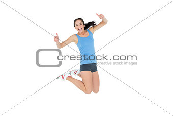 Active sporty woman gesturing thumbs up
