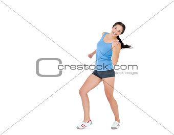 Active woman dancing over white background