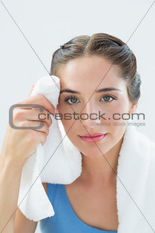 Close up of a woman wiping sweat with towel