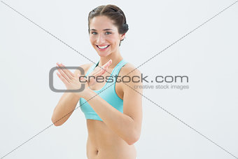 Portrait of a smiling fit young woman in defending posture