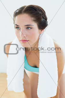 Close up of a tired woman with towel around neck