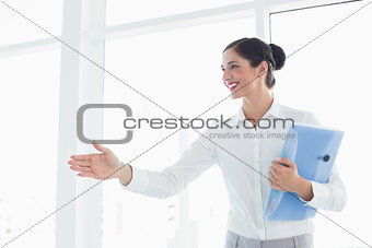 Business woman with folder entering office cabin