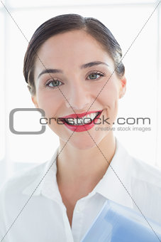 Close up of a smiling business woman in white shirt