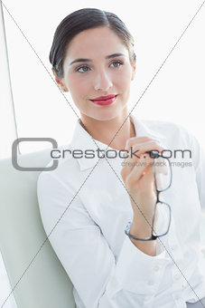 Beautiful business woman sitting on sofa