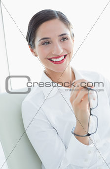 Business woman sitting on sofa