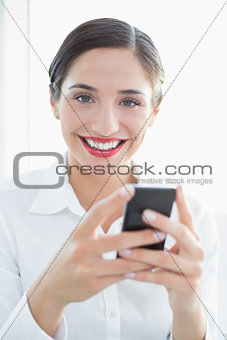 Smiling business woman with mobile phone