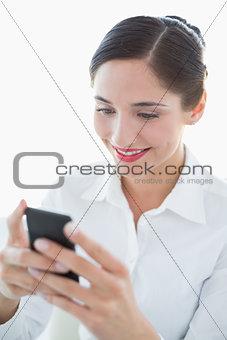 Beautiful business woman using mobile phone