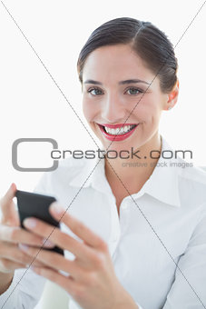 Beautiful young business woman with mobile phone