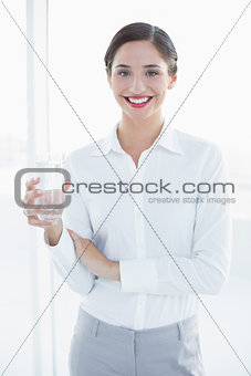 Beautiful business woman with a glass of water