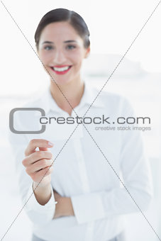 Smiling business woman with hand gesture