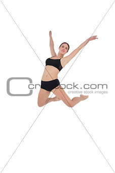 Sporty woman jumping isolated on white background