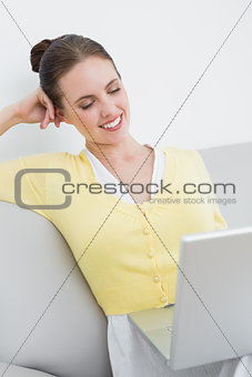 Casual woman using laptop at home