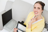 Woman with personal organizer and laptop at home