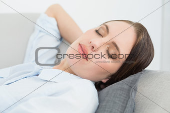 Close up of a well dressed beautiful woman sleeping on sofa