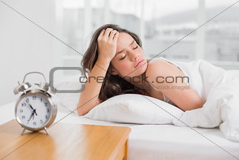 Sleepy young woman in bed