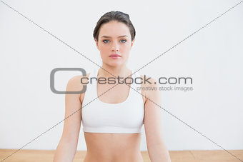 Fit young woman at fitness studio