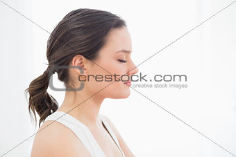 Close up side view of a fit young woman with eyes closed