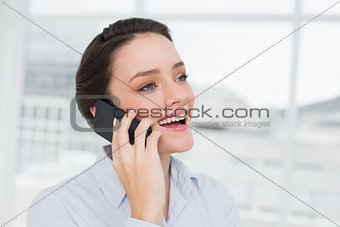 Close up cheerful elegant young businesswoman using cellphone