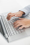 Close up of hands typing on laptop keyboard