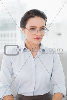 Close up of a serious elegant woman