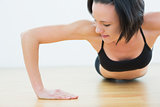 Determined woman doing push ups in fitness studio