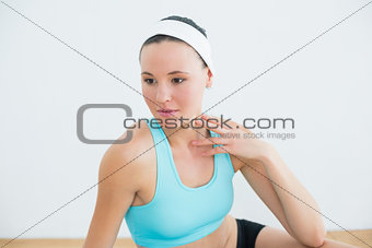 Close up of a thoughtful woman in fitness studio