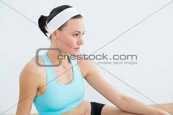 Side view of a thoughtful woman in fitness studio