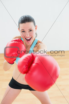 Smiling boxer practicing in fitness studio