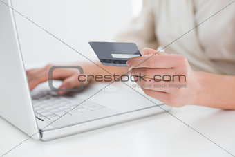 Close up mid section of woman doing online shopping