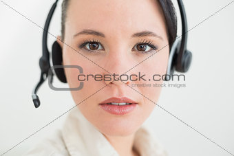 Close up of a beautiful businesswoman using headset