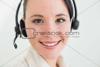 Close up of a smiling beautiful businesswoman using headset