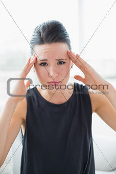 Close up portrait of a businesswoman suffering from headache