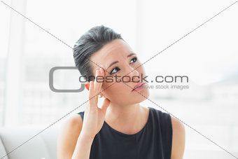 Close up of a businesswoman suffering from headache