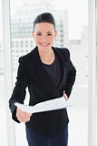 Elegant woman holding out a document in office