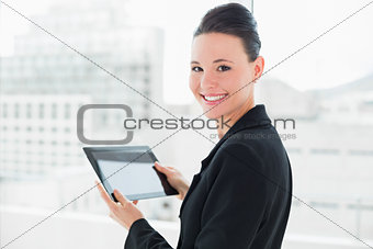 Close up of an elegant businesswoman with tablet PC