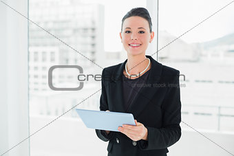 Portrait of an elegant businesswoman using tablet PC