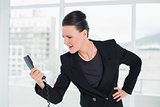 Elegant businesswoman shouting into the phone