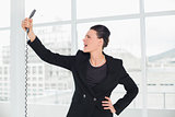Elegant young businesswoman shouting into the phone