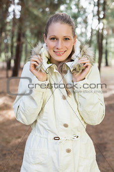 Cute woman having a walk in a forest