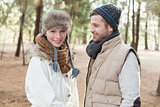 Young couple in winter clothing in the woods