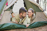 Loving couple lying in tent after a hike
