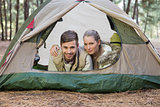 Happy couple lying in tent after a hike