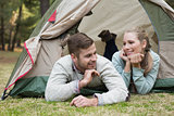 Young couple camping in the wilderness