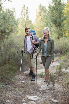 Fit young couple exploring a forest
