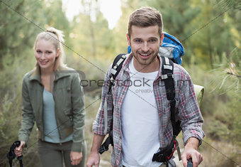 Fit young couple exploring the woods