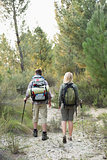 Rear view of a fit young couple exploring the woods